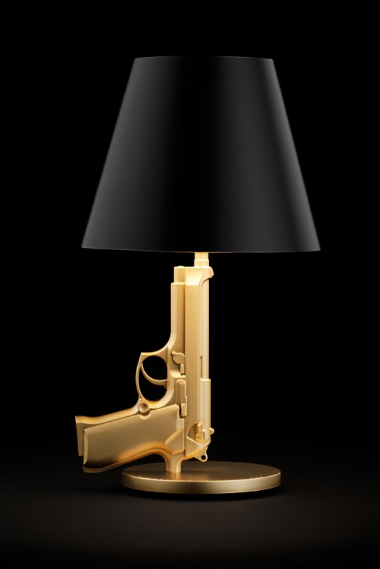 Lampe bedside gun en or by Starck pour Flos