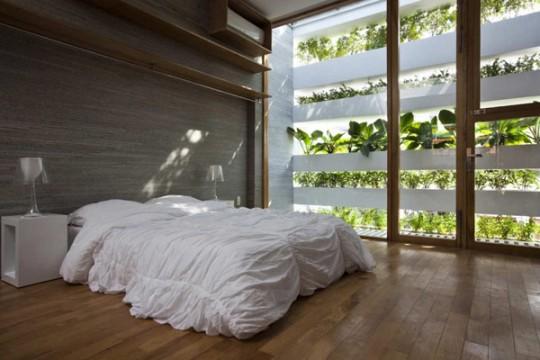 Chambre écologique moderne dans la maison Stacking Green