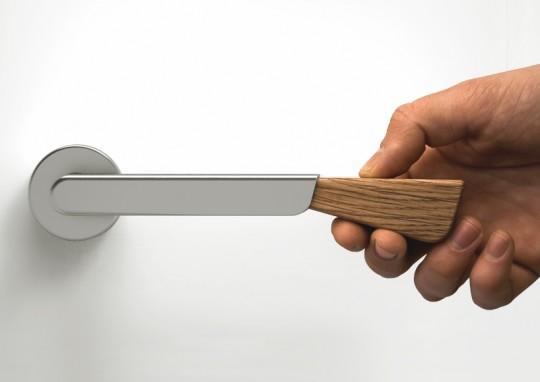 Poignée de porte avec cale-porte intégré