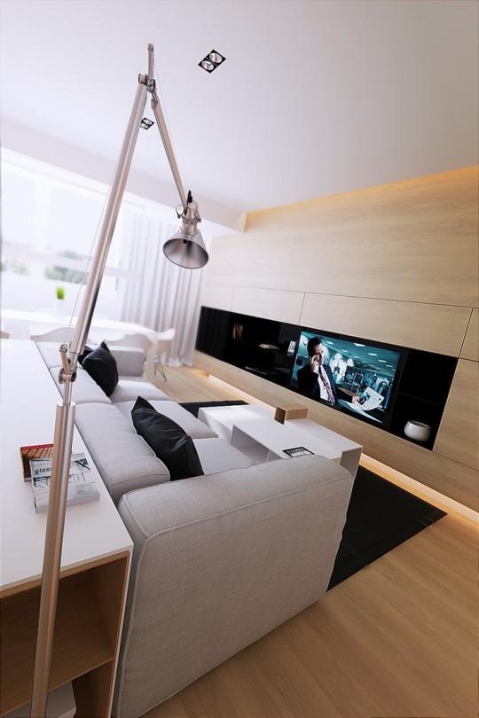 Espace télé avec un canapé gris et beaucoup de bois naturel
