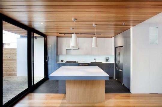 Chambord Residence by naturehumaine - Cuisine moderne en bois