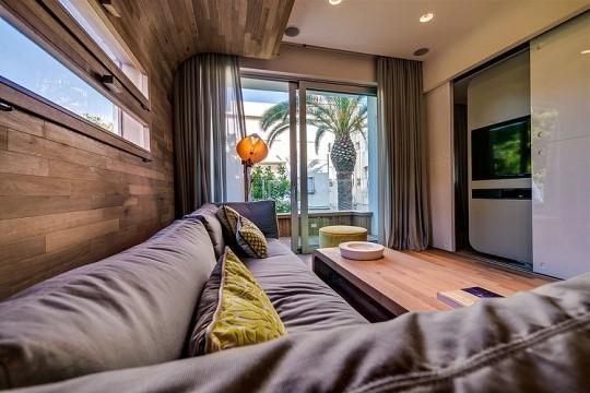 Appartement cosy Tel Aviv - Canapé d'angle en tissu gris