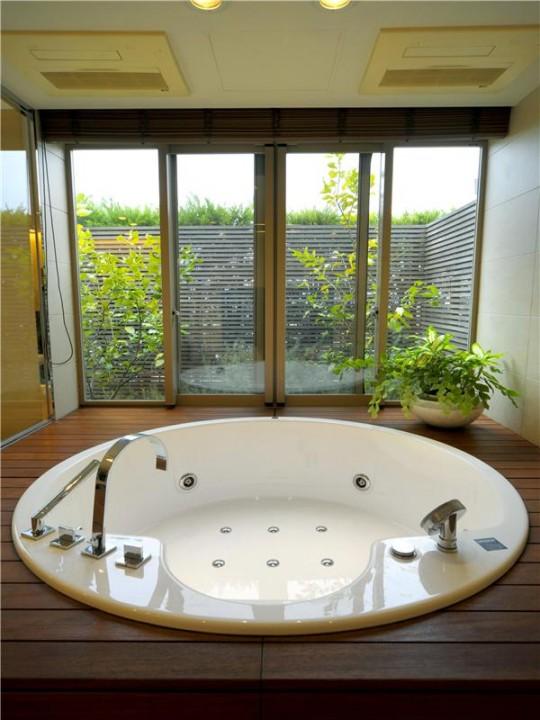L'appartement avec 1 chambre le plus cher du monde - baignoire ronde jacuzzi encastrée