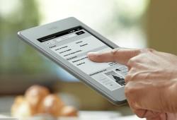 Jetez vos livres et passez au livre numérique tactile avec le Kindle Touch !
